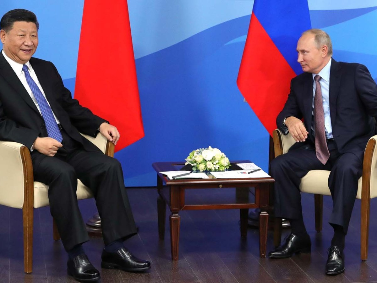 China's President Xi Jinping and Russian President Vladimir Putin meet at the 2018 Eastern Economic Forum in Vladivostok on September 11, 2018. Photo: Russian Presidential Press and Information Office / Anadolu Agency
