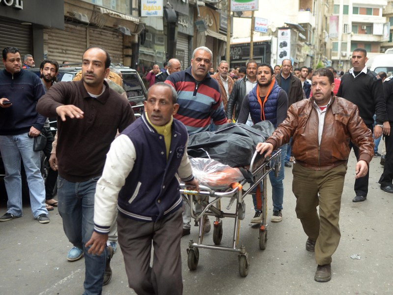 In this file photo taken on April 09, 2017, Egyptians wheel away a body near a church in Alexandria after a bomb blast struck worshippers gathering to celebrate Palm Sunday. - An Egyptian military court on October 11, 2018 sentenced 17 people to death over a series of suicide bombings of churches claimed by the Islamic State group that left dozens dead. Another 19 people were handed life prison terms and 10 were sentenced to between 10 and 15 years, judicial and security officials said. Photo: AFP