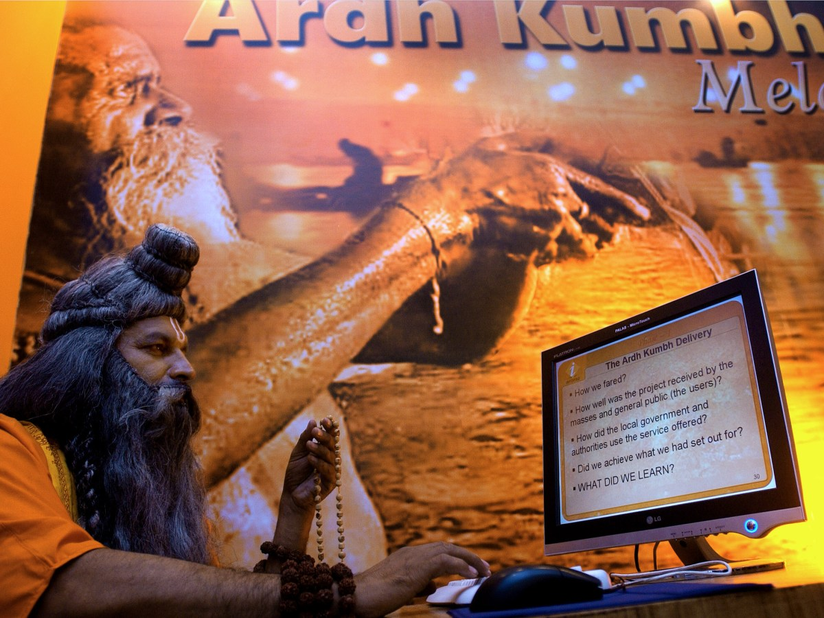 A Hindu holy man at a kiosk showcasing the ArdhKumbh Fair in New Delhi. Photo: AFP