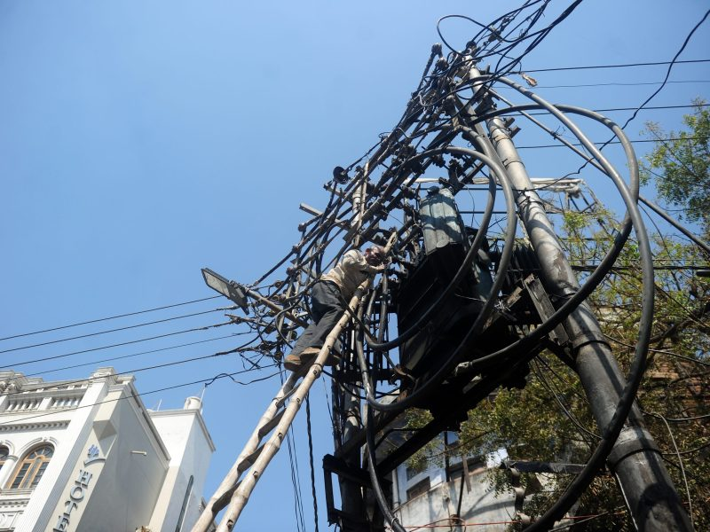 A worker repairs electricity cables at Varanasi in northern Uttar Pradesh state. Photo: AFP
