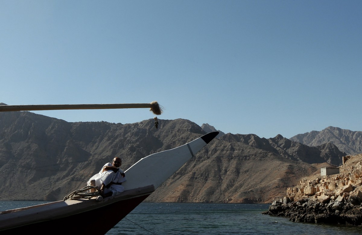 An Omani man rests on a dhow cruising off the coast of Oman along the Strait of Hormuz bordering Iran. Photo: AFP/Marwan Naamani