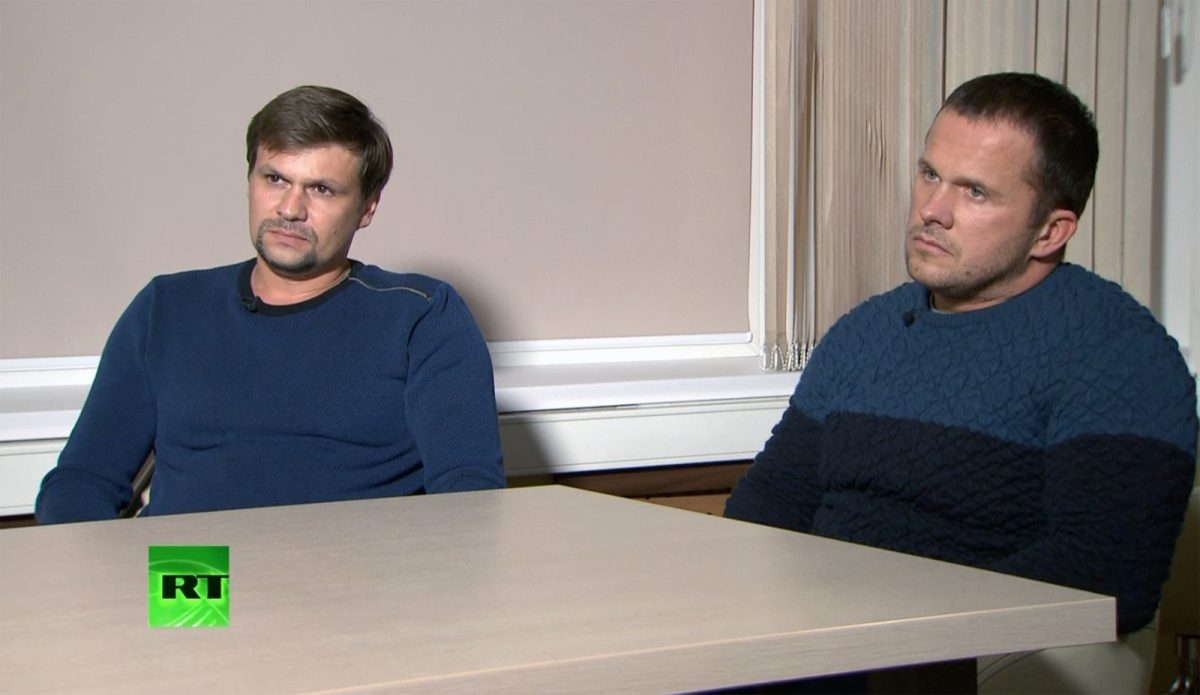 """""""Ruslan Boshirov"""", left, and """"Alexander Petrov"""" listen to a question during their interview with RT in Moscow. Photo: Sputnik"""