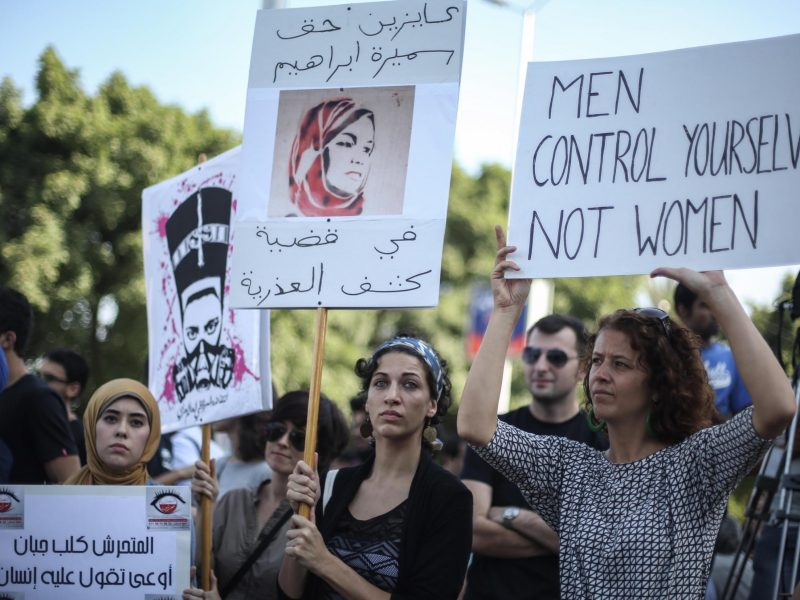 Women hold signs during a protest against sexual harassment in Cairo, Egypt on June 14, 2014. Photo: Ahmed Ismail / Anadolu Agency