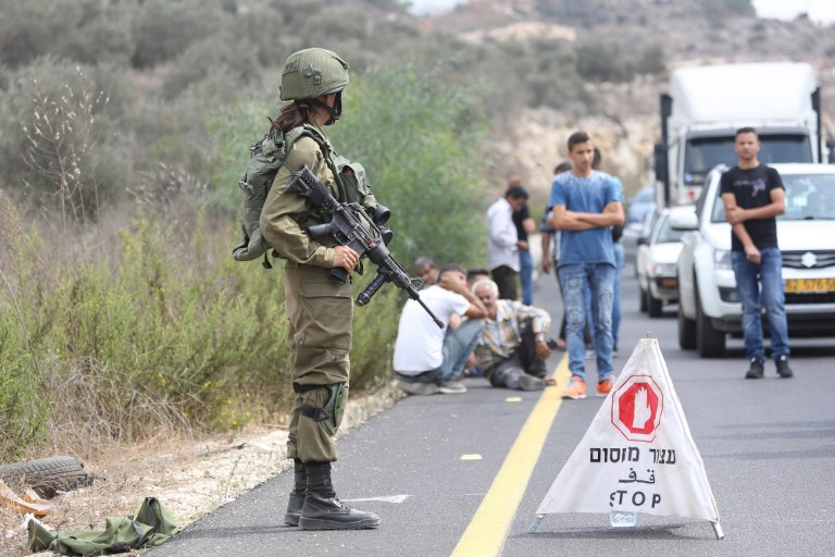 An Israeli soldier guards a road after a deadly gun attack in the northern West Bank on Sunday. Photo: AFP