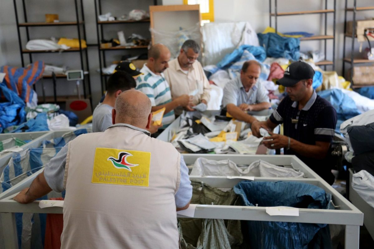 Postal workers sort undelivered mail at the Palestinian central international exchange office in Jericho in the West Bank. Photo: Issam Rimawi / Anadolu Agency