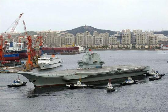 The Type 001A carrier is seen sailing out of the Dalian Shipyard on Sunday morning. Photo: Weibo