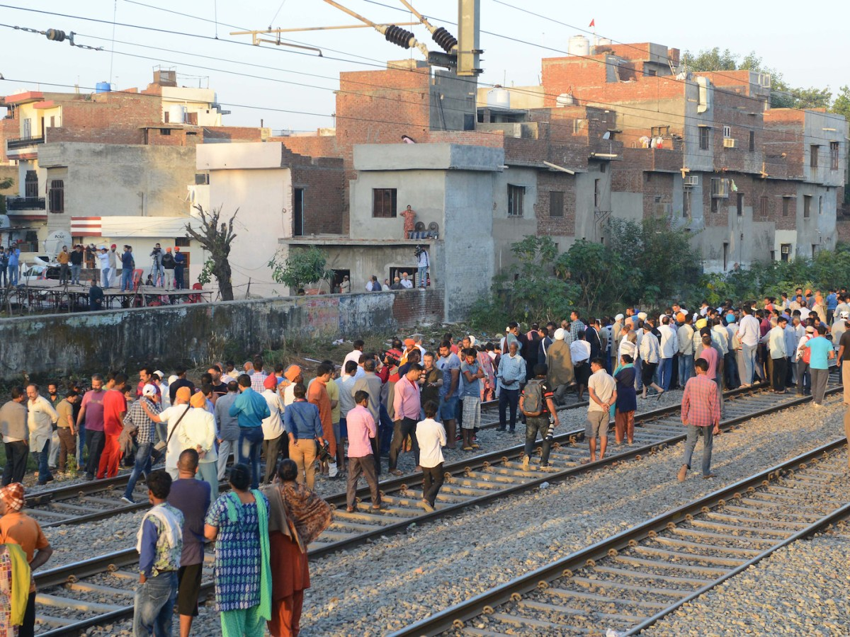 People gather at the scene of an accident in Amritsar, Punjab, on October 20, 2018, after revelers who had gathered on the tracks were killed by a train on October 19. Photo: AFP / Narinder Nanu
