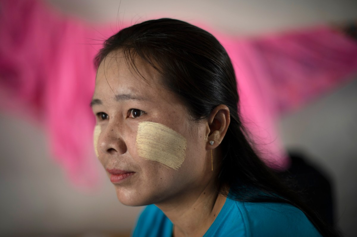 Job brokers target Myanmar citizens such as Ma Htuwey, seen at the Migrant Worker Rights Network in Samut Sakhon last month. Many workers who go to Thailand are trapped in debt bondage despite a 2017 law meant to fight such abuse. Photo: AFP / Lillian Suwanrumpha