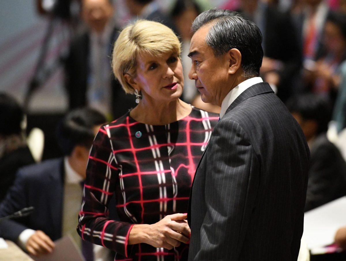 China's Foreign Minister Wang Yi (R) has a quiet chat with Australia's then Foreign Minister Julie Bishop on August 4, 2018. Photo: AFP/Roslan Rahman