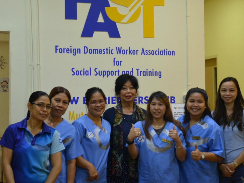 Foreign domestic workers attend the FAST's media event on Monday. Photo: Facebook/FAST.org.sg