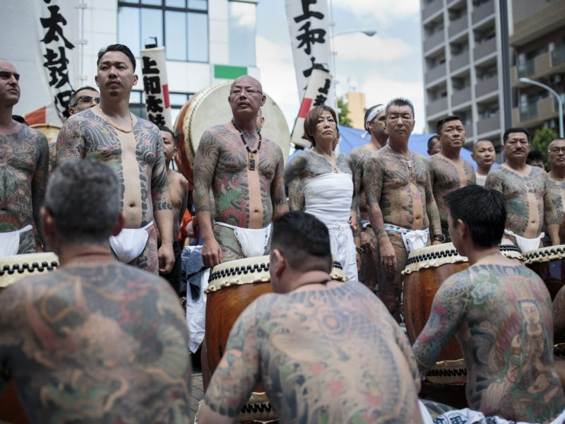 Participants show their traditional Japanese tattoos related to the Yakuza during the annual Sanja Matsuri festival in the Asakusa district of Tokyo on May 20, 2018. Photo: AFP/Behrouz Mehri