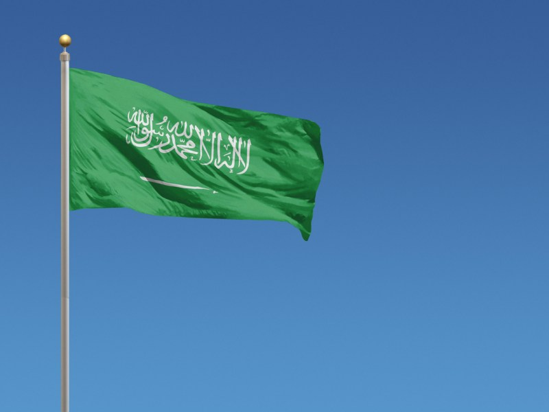 Flag of Saudi Arabia in front of a clear blue sky. Photo: iStock