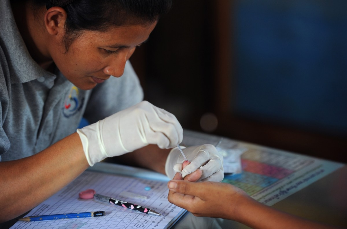 A health worker performs a blood test on a child at a clinic near the Thai-Myanmar border. For more than a decade, the fast-acting artemisinin has been a potent weapon against malaria, but there are fears that resistance to the drug is spreading. Photo: AFP / Pornchai Kittiwongsakul