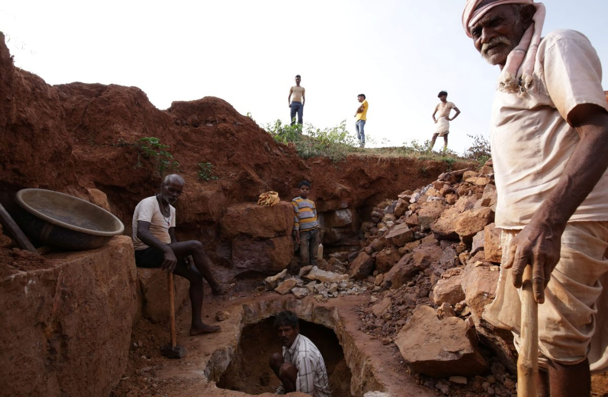 Labourers search for precious stones in shallow pit mines in the Bundelkhand region of Madhya Pradesh state.  Photo by Gagan Nayar / AFP)