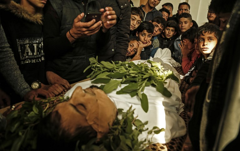 Relatives mourn at the funeral of a Palestinian protester in Beit Lahia in the northern Gaza Strip on November 10. Photo: AFP