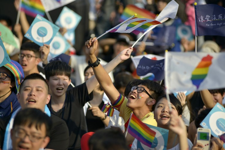 People take part in a rally in support of same-sex marriage near the Presidential Office in Taipei on November 18,, ahead of a landmark vote on LGBT rights on November 24. Photo: AFP