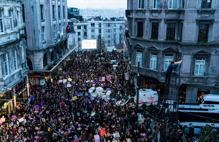 Activists gather to protest against violence against women in Istanbul on Sunday. Photo: AFP
