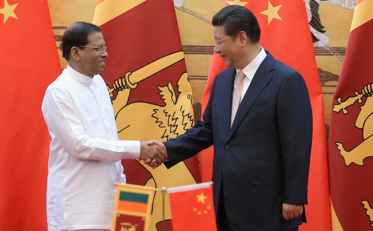 Sri Lankan President Maithripala Sirisena (left) shakes hands with Chinese President Xi Jinping during a signing ceremony in the Great Hall of the People in Beijing on March 26, 2015. Photo: AFP / Feng Li / Pool