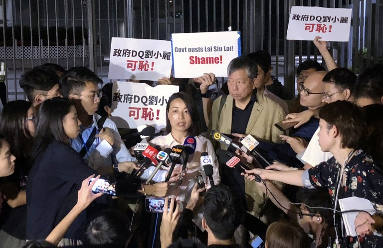 Lau Siu-lai of the Labour Party speaks to the press outside the government headquarters on October 12 hours after being barred from running in the Kowloon West by-election in Hong Kong. Photo: AFP