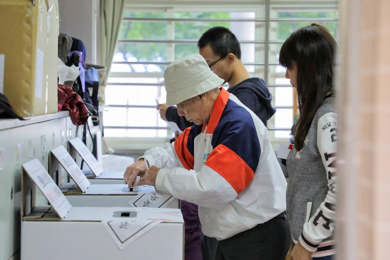 Taiwanese queue up to cast their ballots in a voting station in Taipei, Taiwan, on Saturday Nov 24, 2018. Taiwan holding local elections on Saturday at the mid-point of President Tsai Ing-wen's leadership and the focus will be on the island's sluggish economy and often fraught relations with China. While Tsai is not on the ballot, the polls are seen as a chance for the electorate to rate her performance as they vote for mayors, councils and other positions.