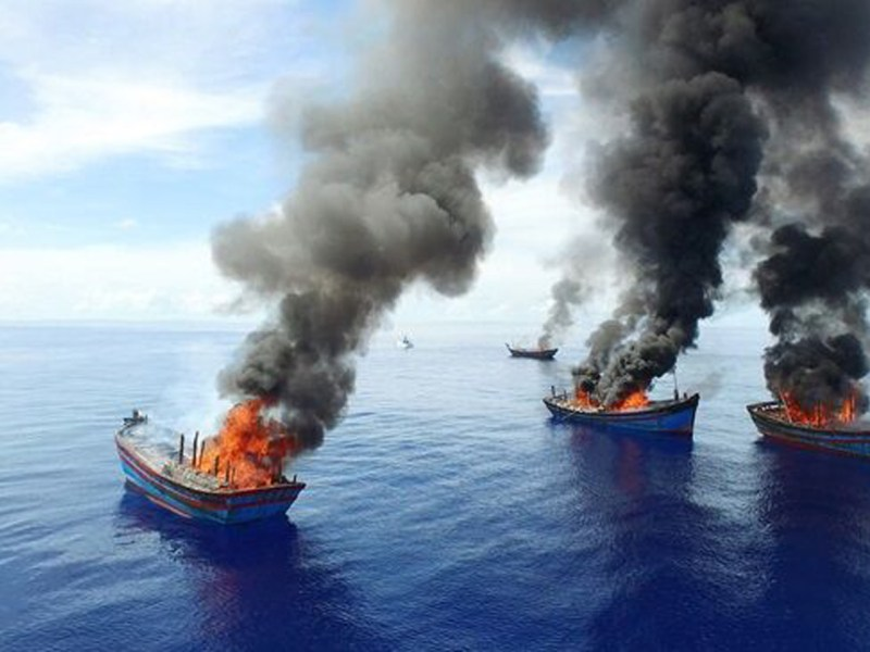 Illegal fishing boats are burnt near the Pacific island nation of Palau, in October 2015 near one of the world's largest marine sanctuaries. Illegal fishing is seen as one of the most serious threats to the world's oceans and marine life. Photo: AFP / The Pew Charitable Trusts / Jeff Barabe