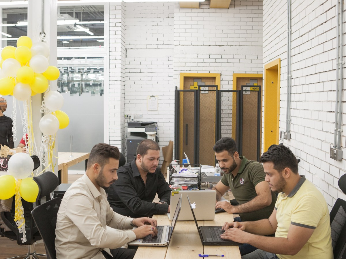 Iraqi entrepreneur Haider Arff Abdul Ameer (back left), founder of Al Muraqib application, a service provider targeting schools, works with his colleagues in Baghdad, Iraq.