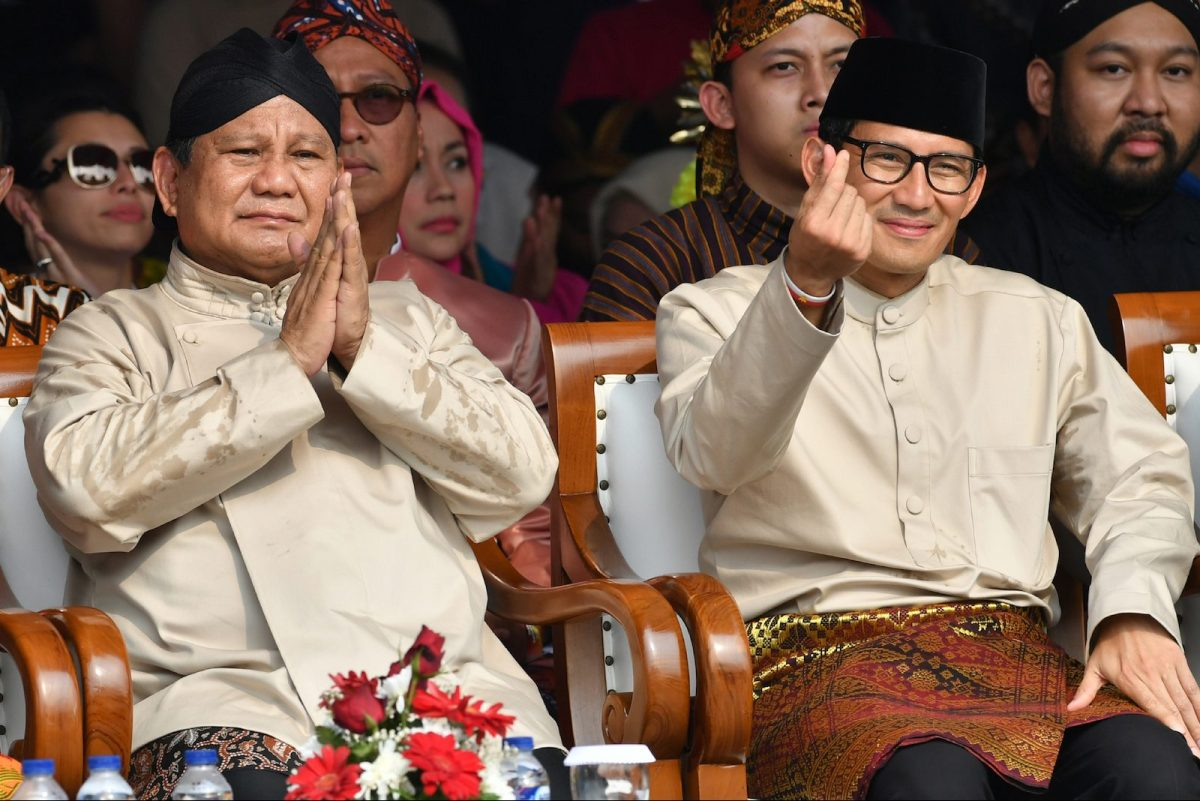 Indonesian presidential candidate Prabowo Subianto (L) and his running mate Sandiaga Uno gesture as they attend a peace declaration for the upcoming general election campaign at the National Monument in Jakarta on September 23, 2018. Photo: AFP/Adek Berry