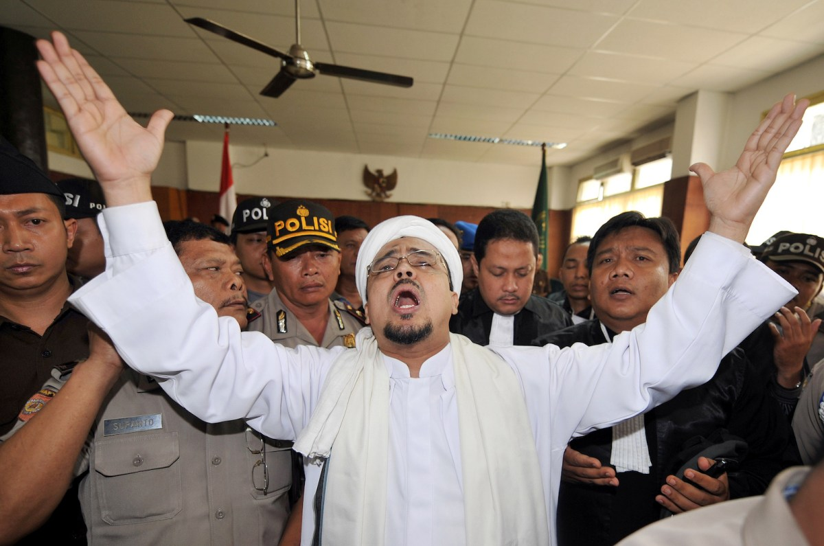 Indonesian Islamic Defenders Front (FPI) leader Rizieq Shihab gestures as he delivers a speech to his supporters inside a court room in Jakarta in a file photo. Photo: AFP/Adek Berry