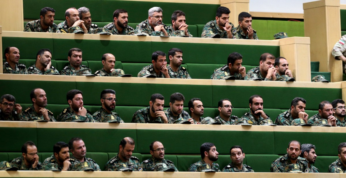 Members of the Iranian Revolutionary Guard listen to a speech in parliament in Tehran on October 7, 2018, over the a bill to counter terrorist financing. Photo: AFP/Atta Kenare