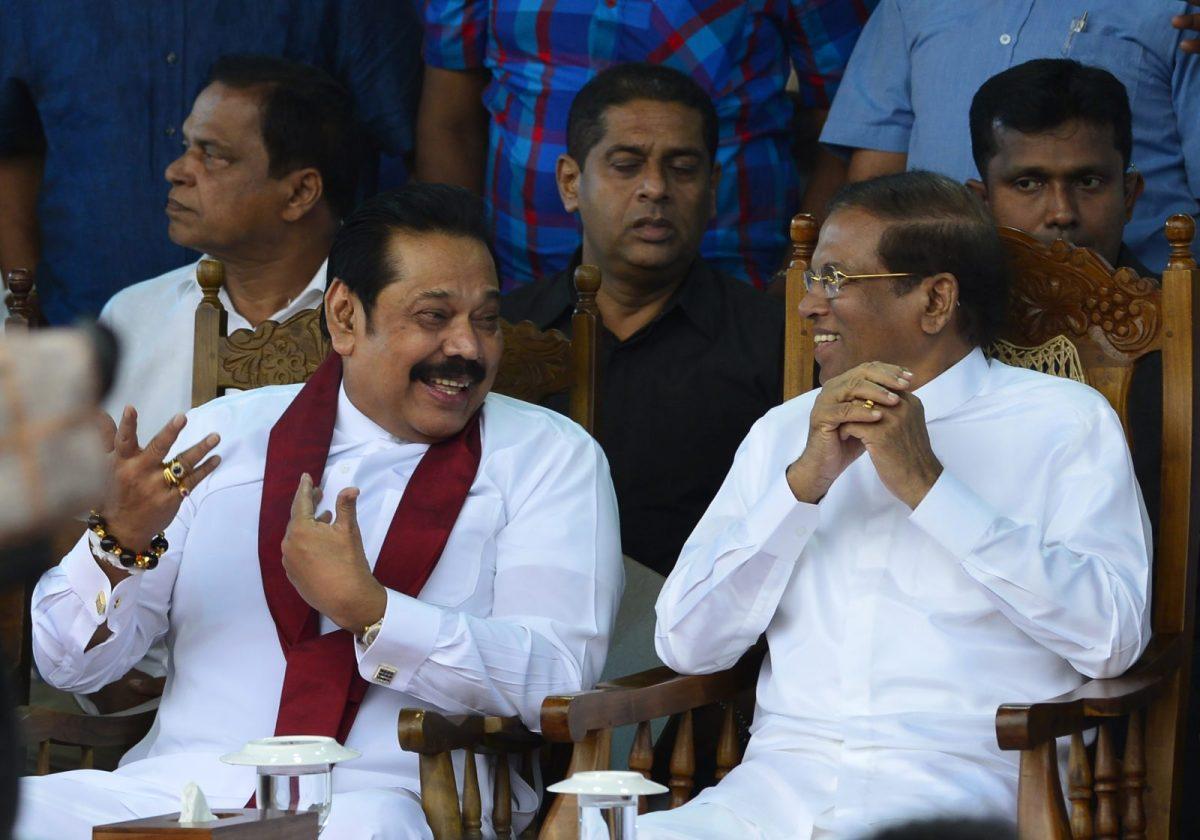 Sri Lanka's former president Mahinda Rajapaksa, left, speaks with President Maithripala Sirisena at a rally in Colombo on November 5, 2018. Photo: AFP