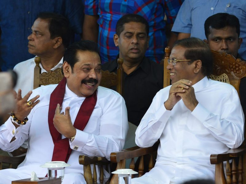 Sri Lanka's former president Mahinda Rajapaksa, left, speaks with President Maithripala Sirisena at a rally in Colombo on November 5, 2018. Photo: AFP