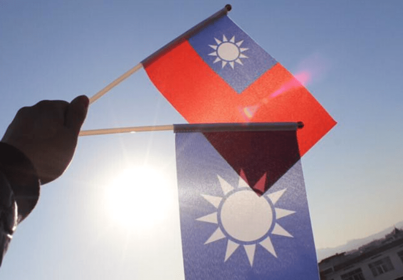 The Taiwanese flag and the KMT flag. Members of the opposition KMT party now control 15 cities and counties in Taiwan. Photo: Facebook