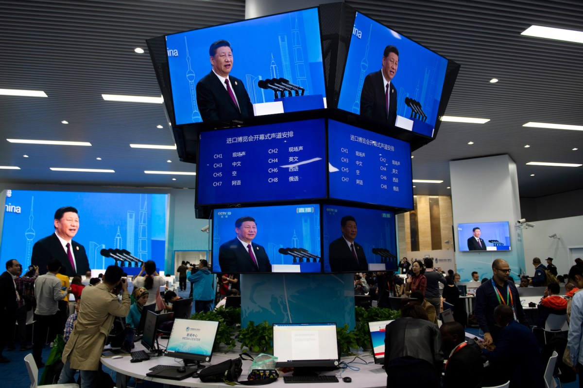 President Xi Jinping's speech is streamed across the media center during the opening ceremony of the first China International Import Expo in Shanghai. Photo: AFP / Johannes Eisele