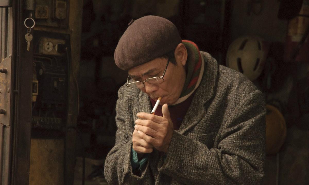 A Vietnamese man lights a cigarette. Photo: iStock