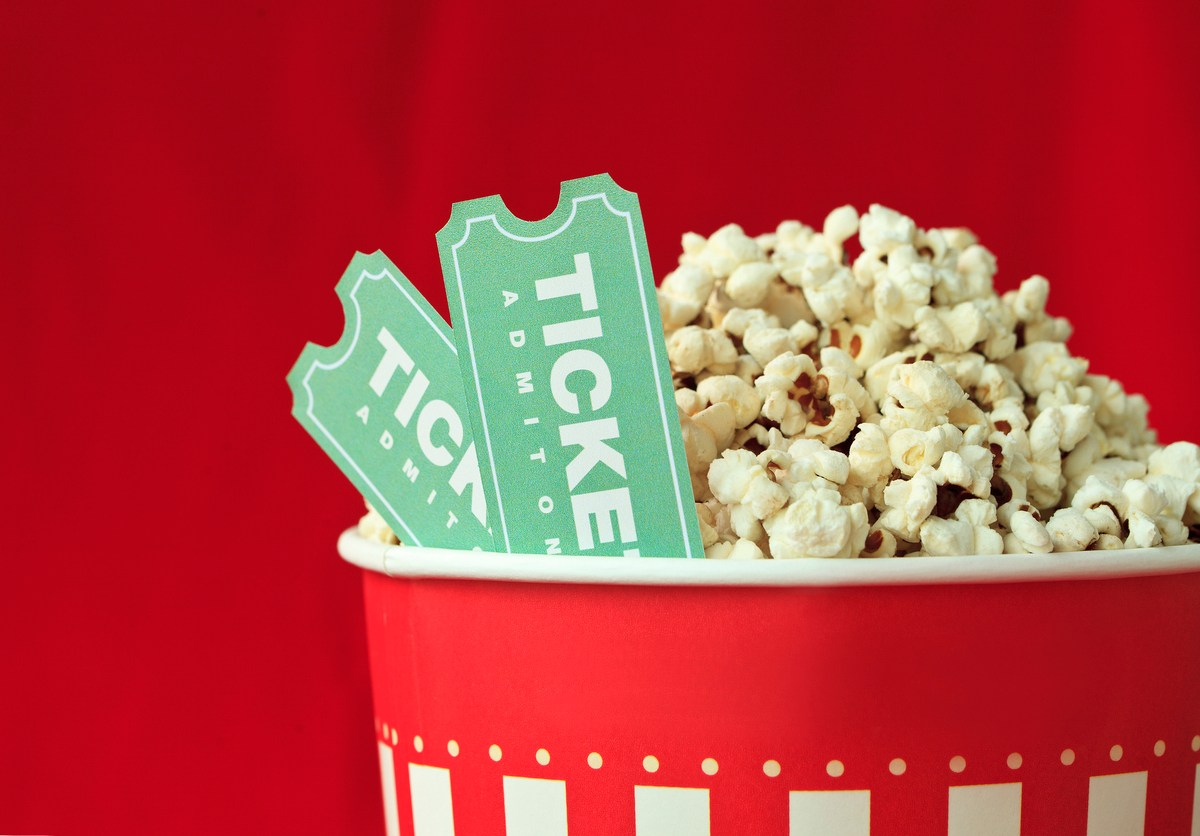 Popcorn Bag And Movie Ticket On Red Background. Image: iStock