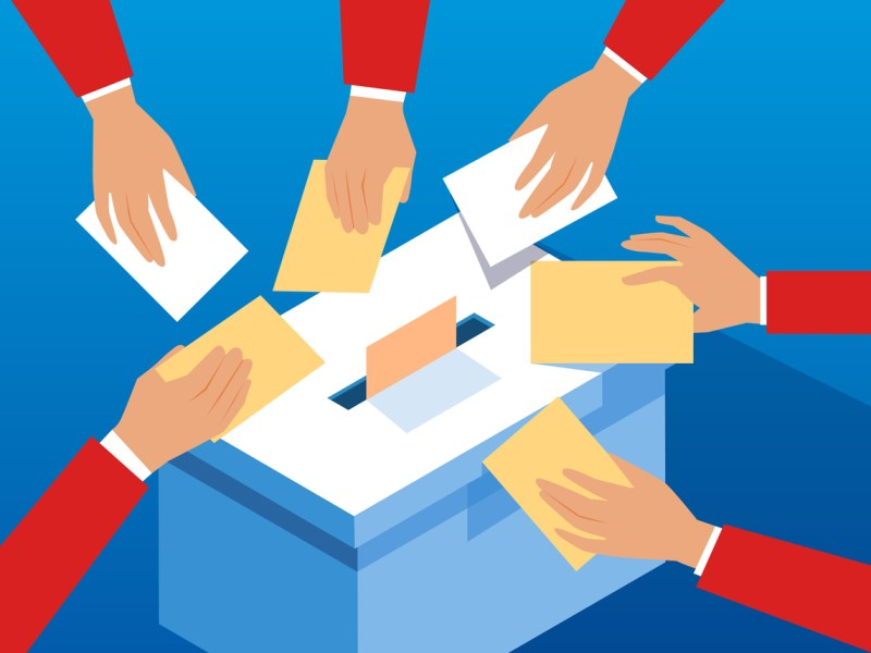 Voting hands and ballot box. Image: iStock