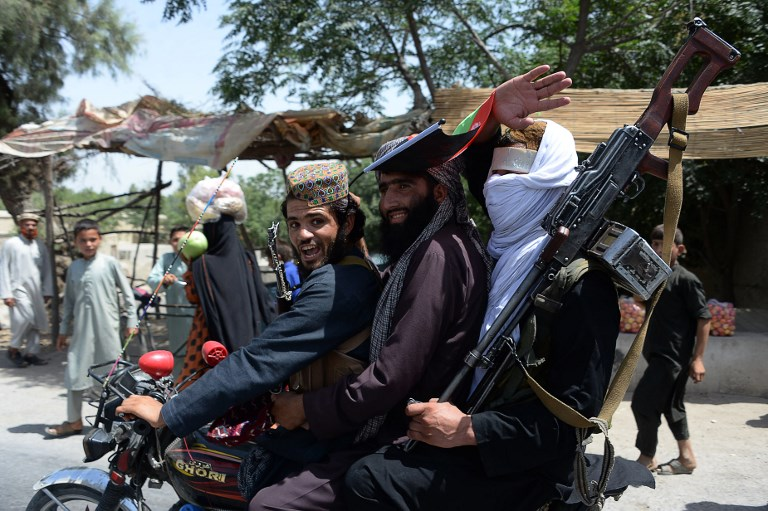 Afghan Taliban militants celebrate a ceasefire on the outskirts of Jalalabad on June 16, the second day of Eid. Photo: AFP