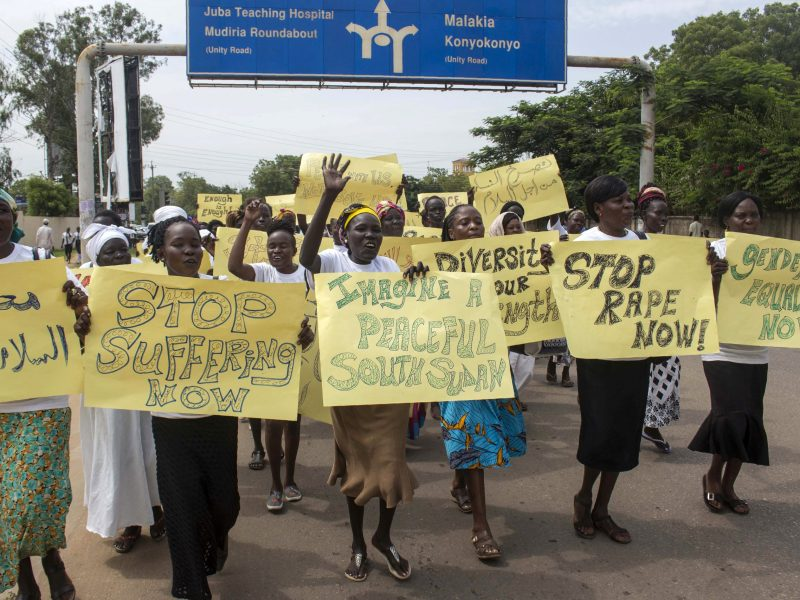 Women march carrying placards with messages demanding peace and their rights, on the streets of South Sudan's capital, Juba on July 13, 2018, following alledged ruthless and brutal attacks on civilians in South Sudan by government forces and their allies that may amount to war crimes, the UN says. - A ceasefire agreement signed at the end of June 2018, by South Sudanese President Salva Kiir and opposition leader Riek Machar, yet another failed attempt by the international community to end a five year civil war, appears further imperiled by parliament's vote to extend Kiir's term in office until 2021 amid failure to hold elections this year. Photo by BULLEN CHOL / AFP