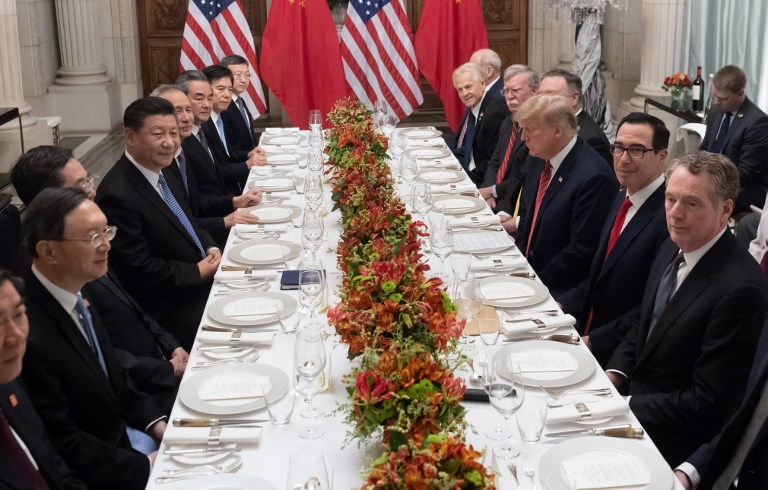 US President Donald Trump  and Chinese President Xi Jinping along with members of their delegations attend a dinner meeting at the end of the G20 Summit. Photo: AFP/Saul Loeb