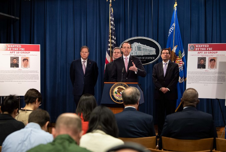 US Deputy Attorney General Rod Rosenstein speaks at a press conference about Chinese hacking. Photo: AFP