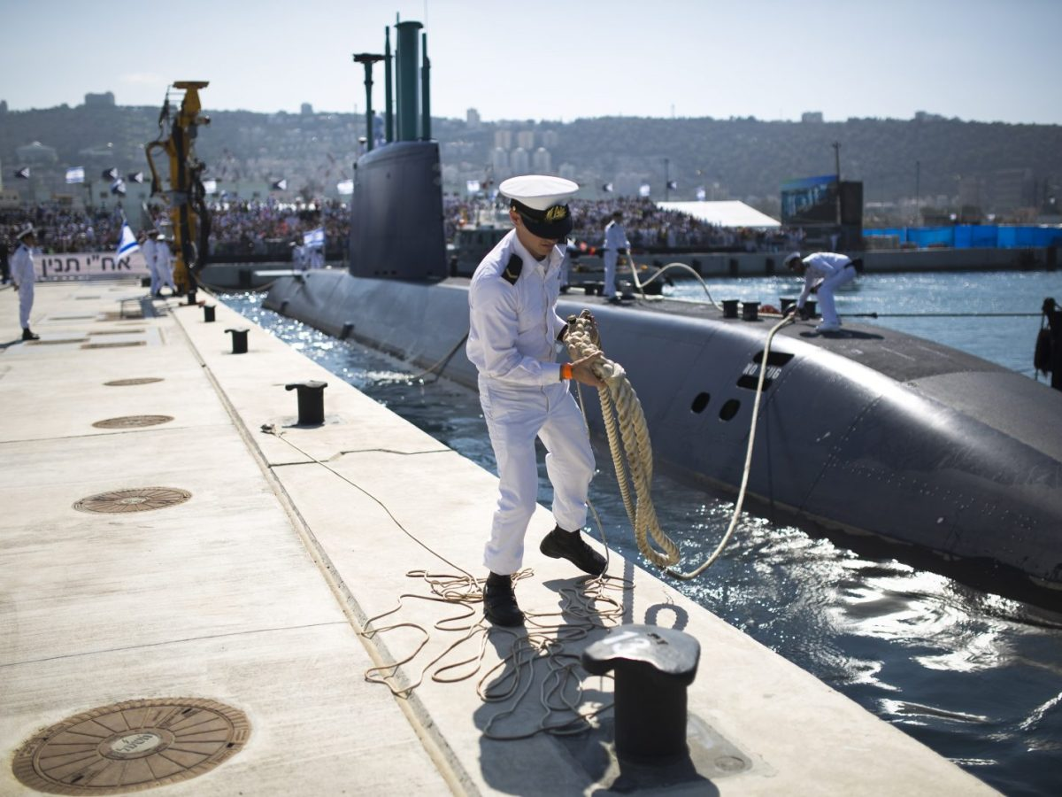 An Israeli naval officer holds the mooring rope of the INS Tanin, a Dolphin AIP class submarine, on its arrival at a naval base in the northern Israeli city of Haifa. Photo: AFP