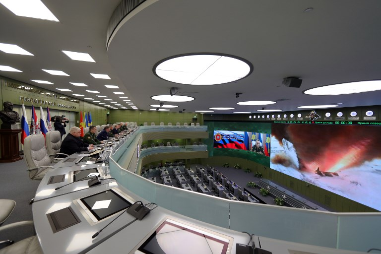 Russian President Vladimir Putin watches the launch of the Avangard weapon with hypersonic gliding cruise bloc at the National Defense Control Center via a video conference. Sputnik/Mikhael Klimentyev
