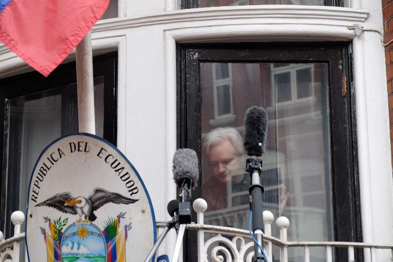 Julian Assange speaks to the media from the balcony of the Embassy of Ecuador in London. Photo: NurPhoto via AFP/Jay Shaw Baker