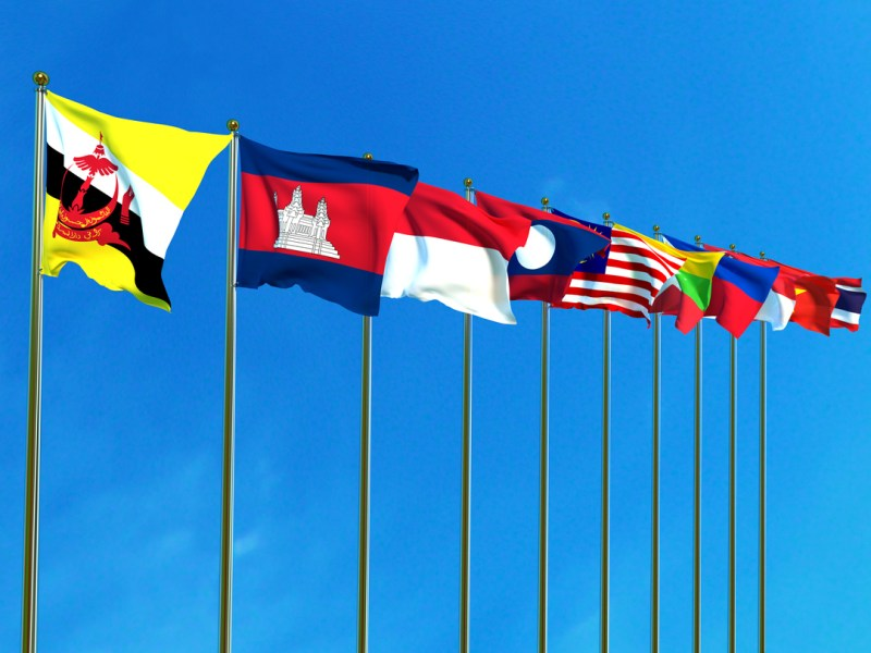 Asean Economic Community flags on the blue sky background. illustration: iStock