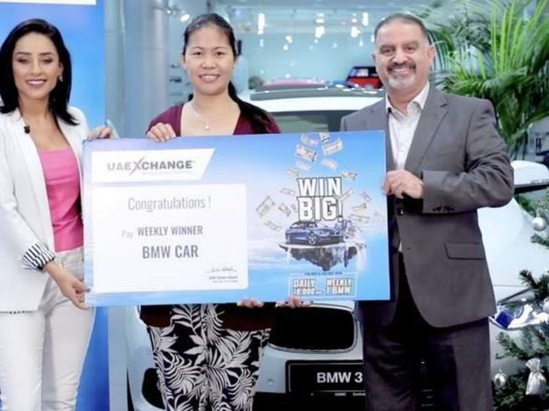 Florinza Santos with a certificate for the luxury car she won in a raffle. Photo: Facebook
