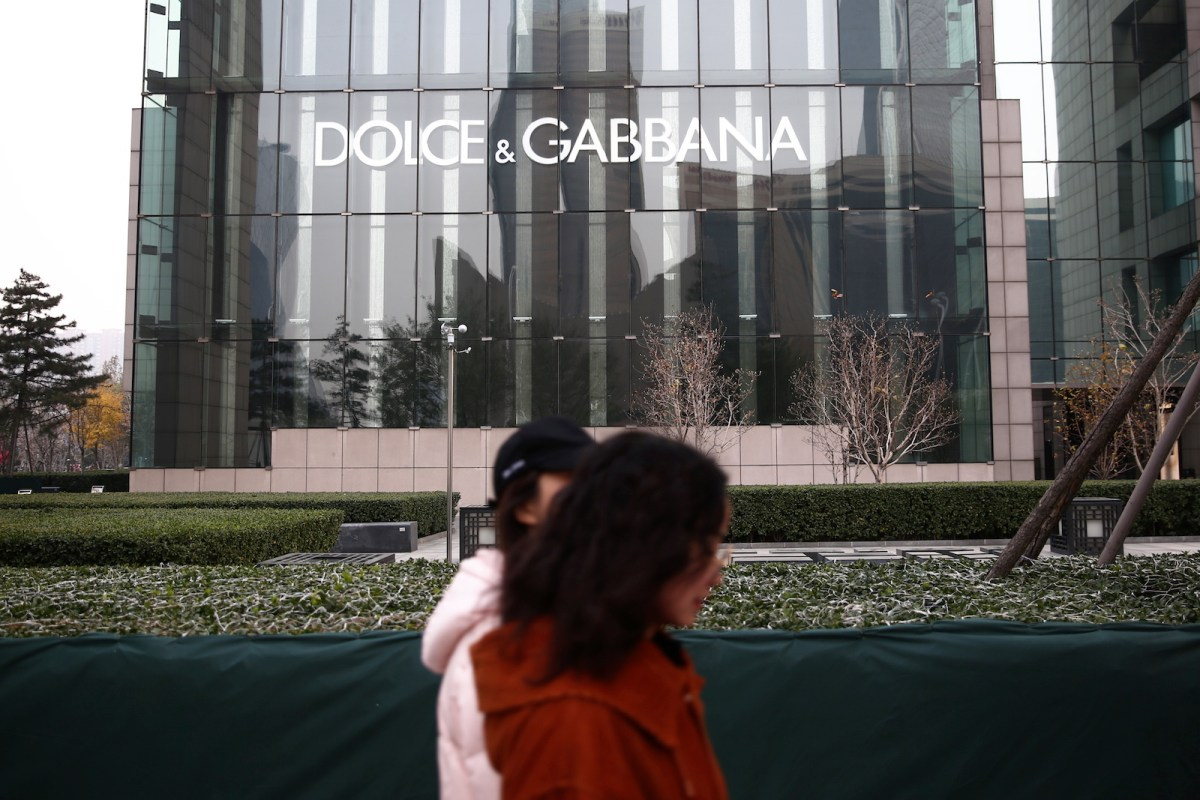 Pedestrians walk past a boutique store of Dolce & Gabbana at a shopping mall in Beijing, China, 23 November 2018.Photo: AFP Forum
