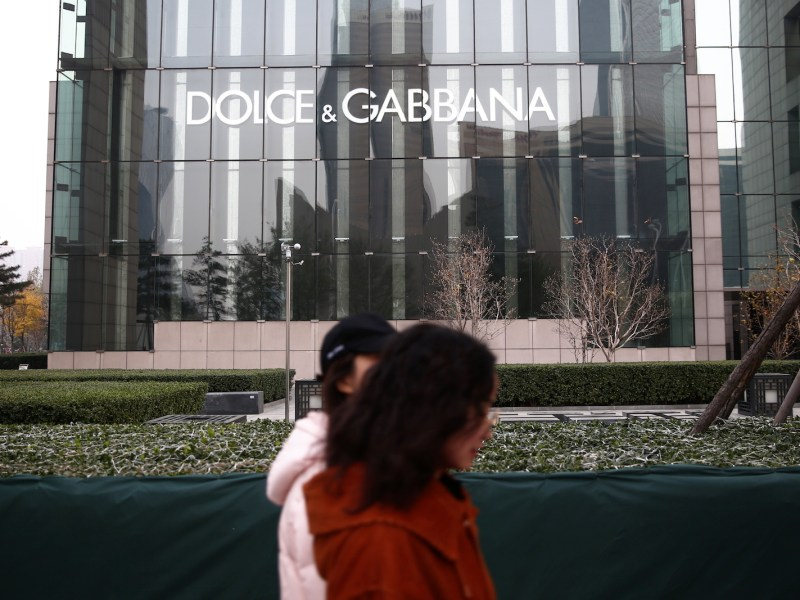 Pedestrians walk past a boutique store of Dolce & Gabbana at a shopping mall in Beijing, China, 23 November 2018. Photo: AFP Forum