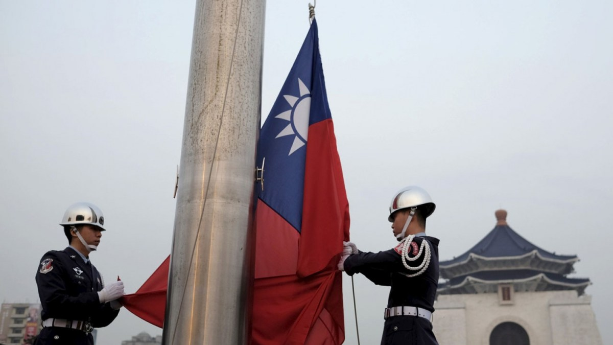 Honor guards prepare for a flag-raising ceremony in front of the Chiang Kai-shek Memorial Hall in Taipei. Photo: Twitter