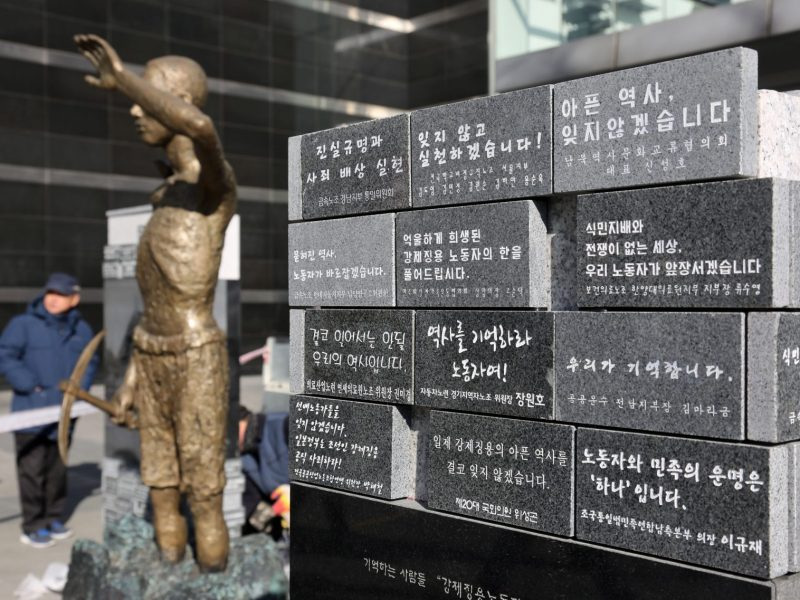 A statue of a laborer taken to work at a Japanese company during World War II in front of Yongsan Station in Seoul, South Korea. Photo: AFP/The Yomiuri Shimbun