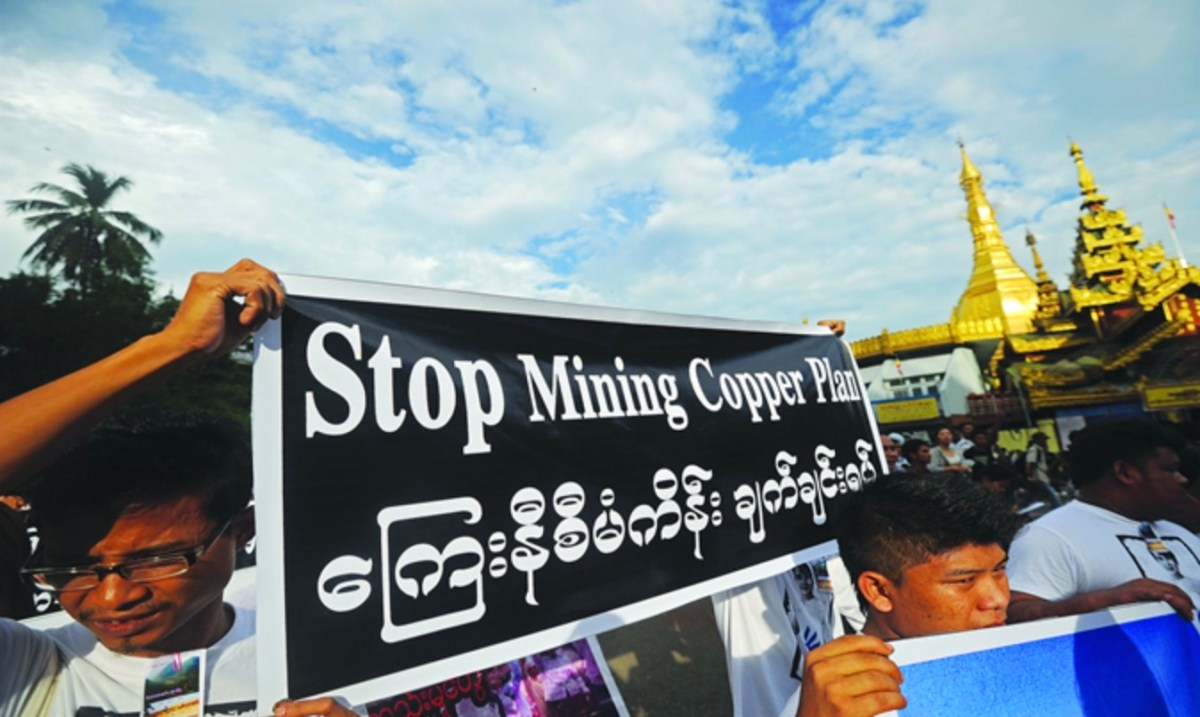 Protestors against the China-backed Letpadaung copper mine unfurl a banner in Yangon, Myanmar. Photo: Facebook